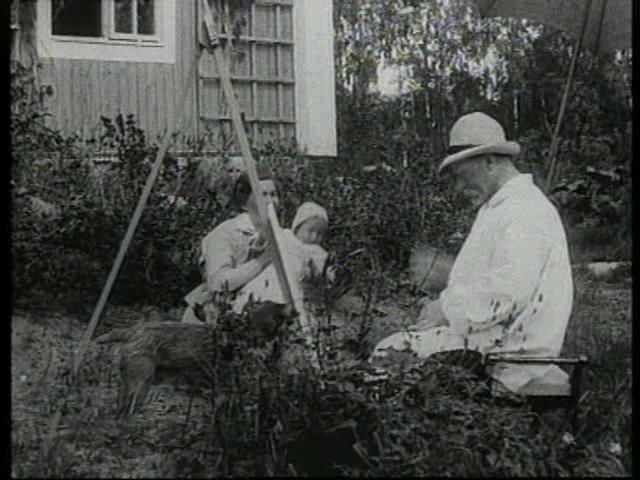to go back in time.....Carl Larsson i Sundborn by Carl Larsson. (Sundborn 1917-06-00) Carl Larsson med hustru välkomnar mågen dr Kanström med familj.