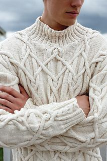 Intricate cables are brought together with the ribbed neckline, cuffs and hem in this slightly oversized funnel neck pullover.