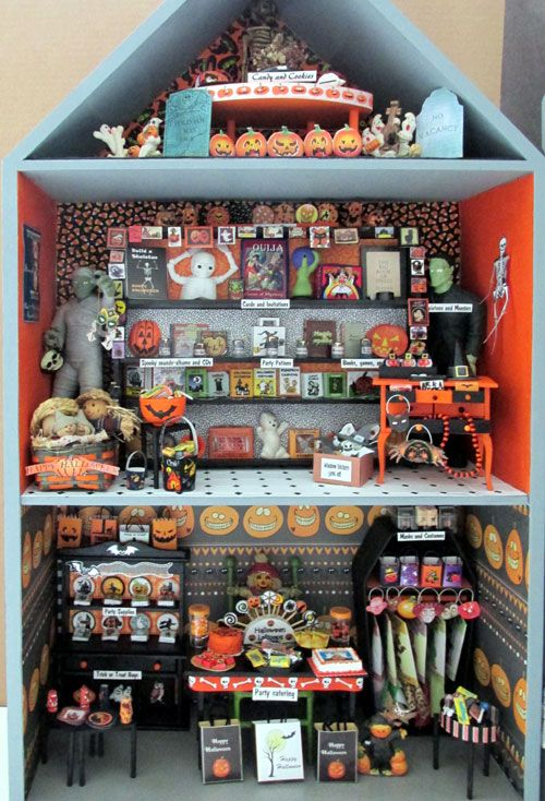 I'm planning on doing something similar out of a closetmaid shelf unit (black) and going all out with a Halloween theme