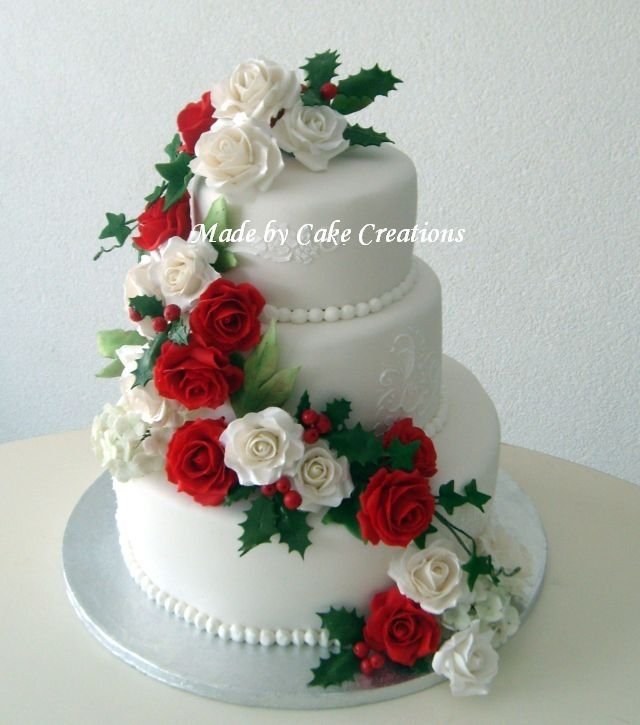 Red and white roses with holly