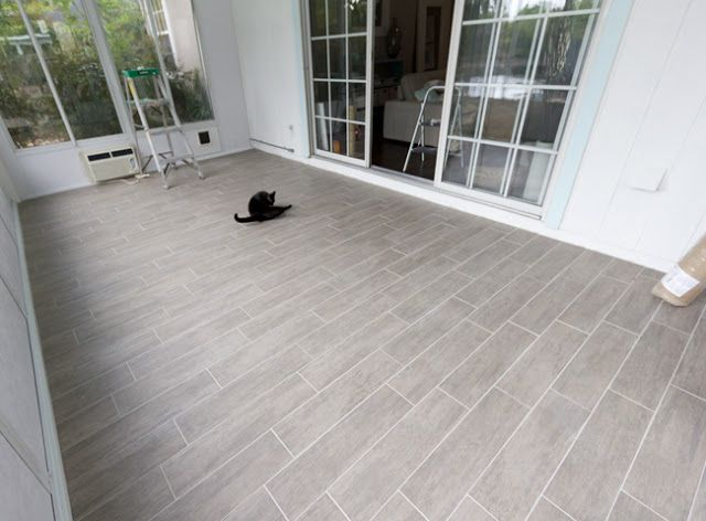 Gray tile looks like wood - sunroom floor: Kitchens Floors, Gray Tile, Sunroom Reveal, Tile Floors, Porcelain Tile, Laundry Rooms, Bathroom Floors, Sunroom Floors, Faux Wood Tile