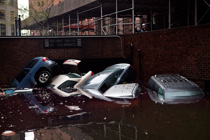 Cars floating in a flooded subterranian basement following Hurricaine Sandy on October 30, 2012 in the Financial District of New York, United States