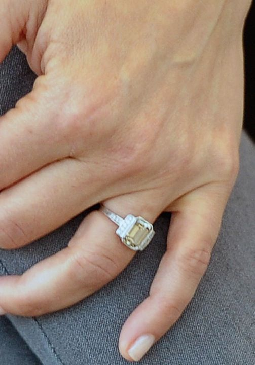 Kristen Bell's engagement ring - fancy colored emerald cut with side diamonds