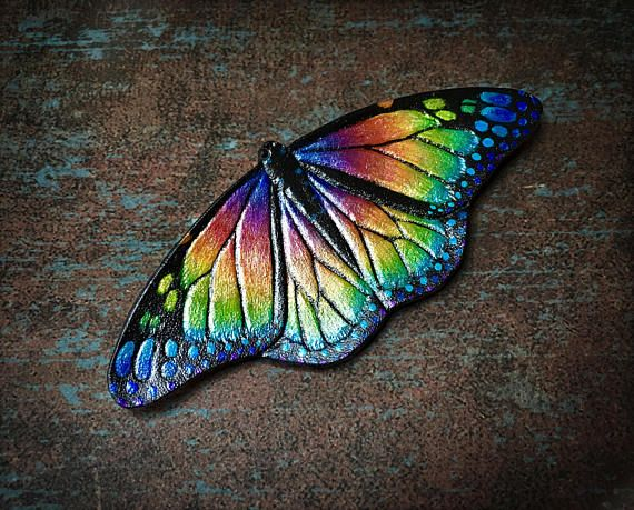 Rainbow monarch butterfly tooled leather hair barrette or brooch by Gemsplusleather - 44.44EUR #butterfly #monarch #monarchbutterfly #rainbow #handmade #handpainted #jewelry #jewelrymaking #diy #leather #leathercraft #art #artisan #brooch #hairclip #hair #beauty