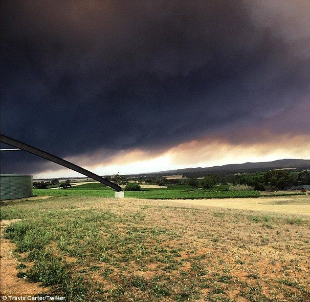 Dramatic pictures taken on Wednesday afternoon showed the dark skies as fires continued to...