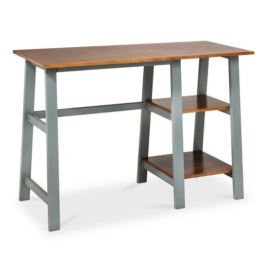 Form and function combine beautifully in the Threshold??™ Trestle Desk. This contemporary piece of home furniture is a fantastic addition to your work space, home office or art studio thanks to its simplistic carpenter bench-style design. Featuring two fixed shelves, a sleek lacquered finish and a sturdy hardwood construction.