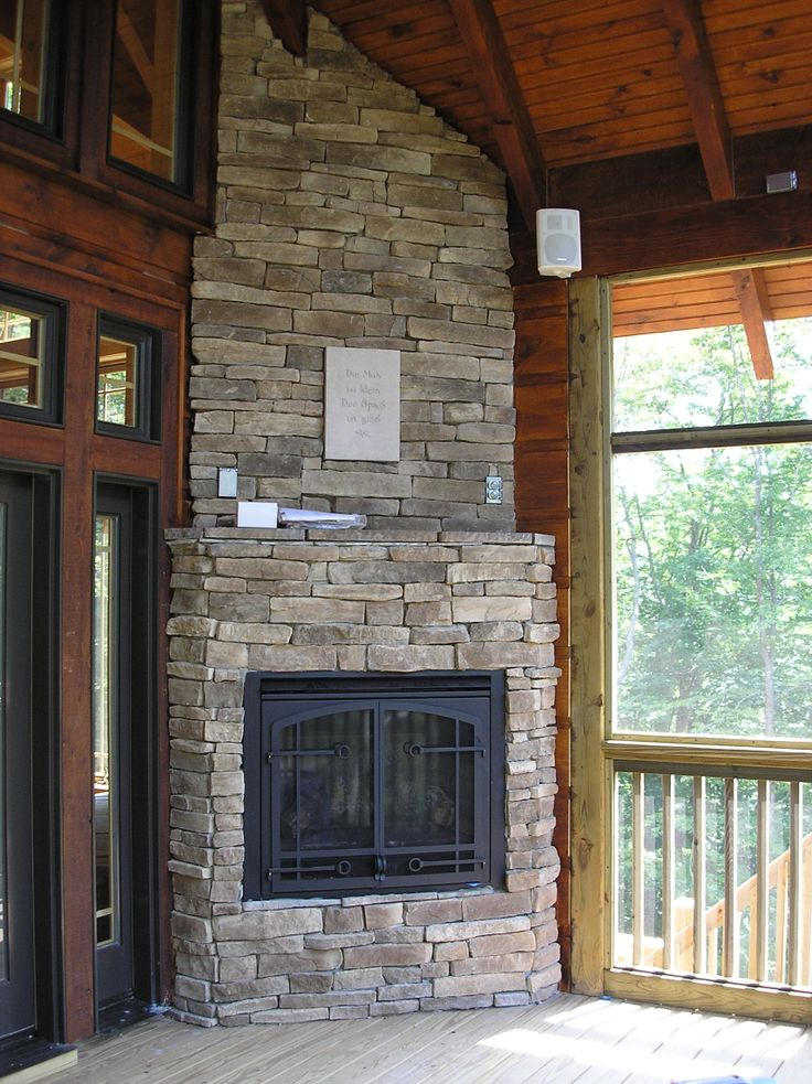 Outdoor gas fireplace on a screened in porch surrounded by ... on Outdoor Gas Fireplace For Deck id=55187