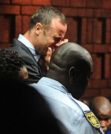 Man Superman Gunman | Oscar Pistorius breaks down during his first court appearance in Pretoria. Pistorius allegedly shot and killed Reeva at his Pretoria home on Valentine's Day 2013. Reuters/www.stuff.co.nz
