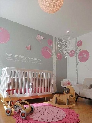 Most of us wouldn't think to use grey on the walls for a little girl's room, but this example shows that with just the right touches of femininity, it's the perfect wall shade. We love the use of tree decals and the words on the wall, making this a peaceful room for the sweetest of slumbers.