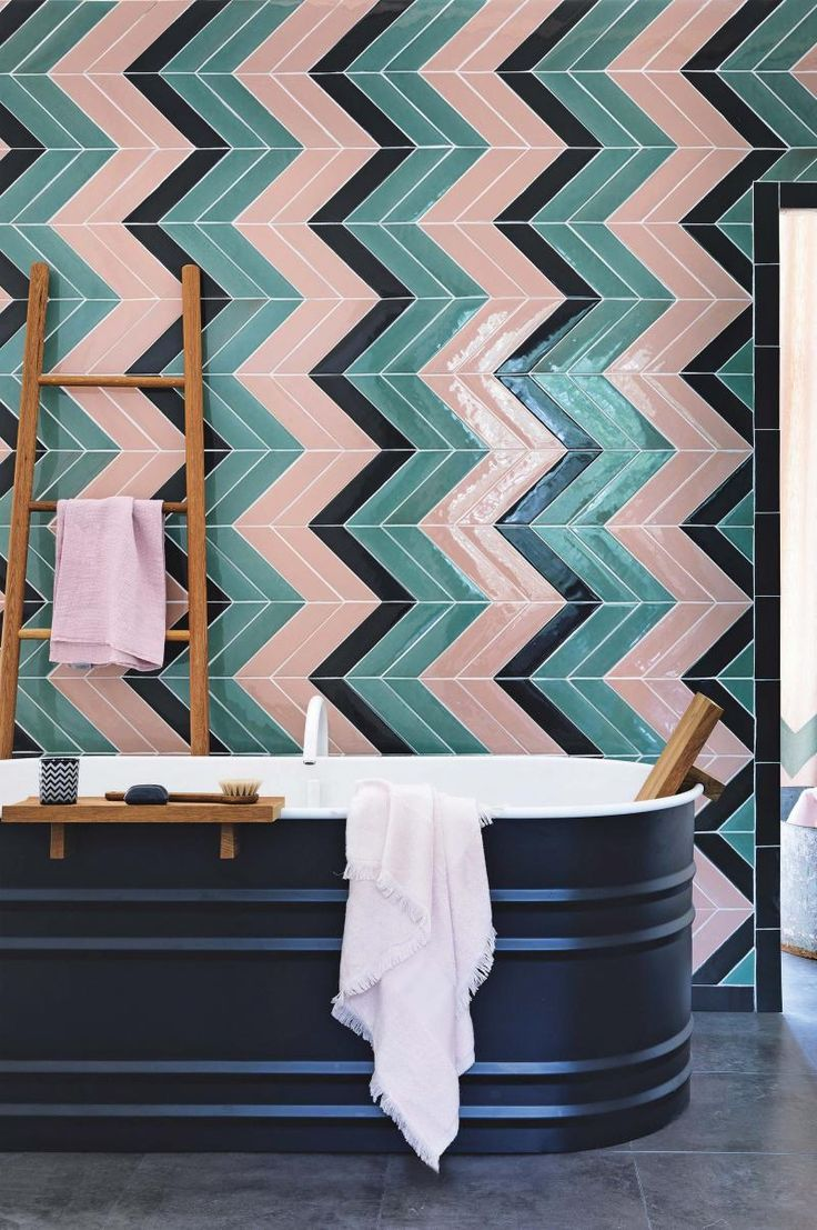Patricia Urquiola steel bath and multi-toned chevron wall tiles | styling by Leesa O'Reilly