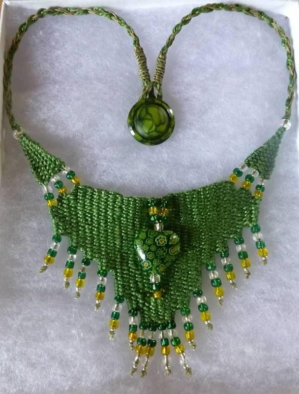 """""""Green Flower Heart"""" - 2013, Fixed Length Choker, Vintage Button, Glass Bead Centerpiece, AVAILABLE. Woven by Terri Scache Harris, theravenscache.shutterfly.com   Hand woven, handwoven, weaving, weave, needleweaving, pin weaving, woven necklace, fashion necklace, wearable art, fiber art."""