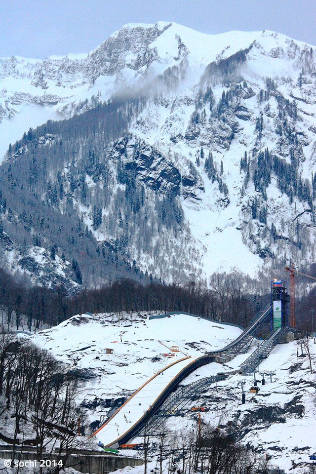 """A mountain full of ski trails...& the strange looking """"roads"""" at the base.  It gives me both the height & the  steepness of the mountain.  It also shows me the same for the jumps, including the distance the jumpers """"fly"""". Ski Jumping Photos 