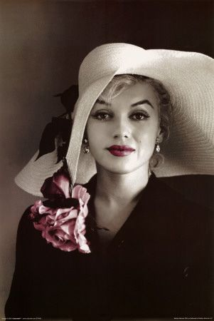 Marilyn Monroe .... a beautiful face that looked even more beautiful peeping out from under a big hat. A little feminine mystique. http://pinterest.com/fancybt/boards/