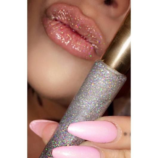 "Our ""HOLOGLOSS"" Holographic Lip Gloss is a clear gloss with the extra-fine holographic glitter. It will be a perfect addition to your collection! It can be appl"