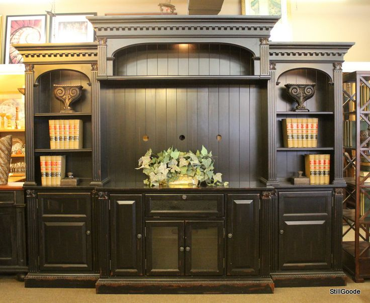 Large black entertainment center by Legends Furniture with touch lighting, storage cabinets and display shelves.  #OnTheShowroomFloor #Large #Entertainment #Center #Legends #LegendsFurniture #StillGoode