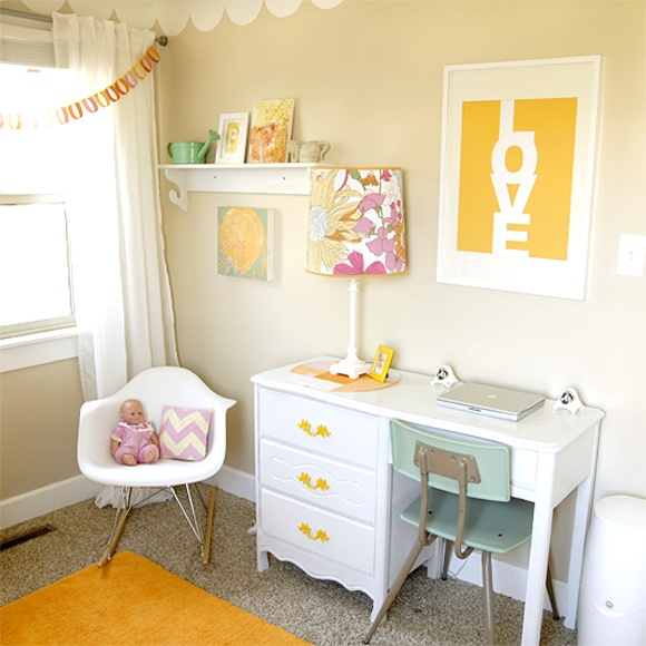 Kids room: colorful drawer pulls on white desk