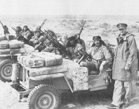 David Stirling (standing) with some of his early SAS.