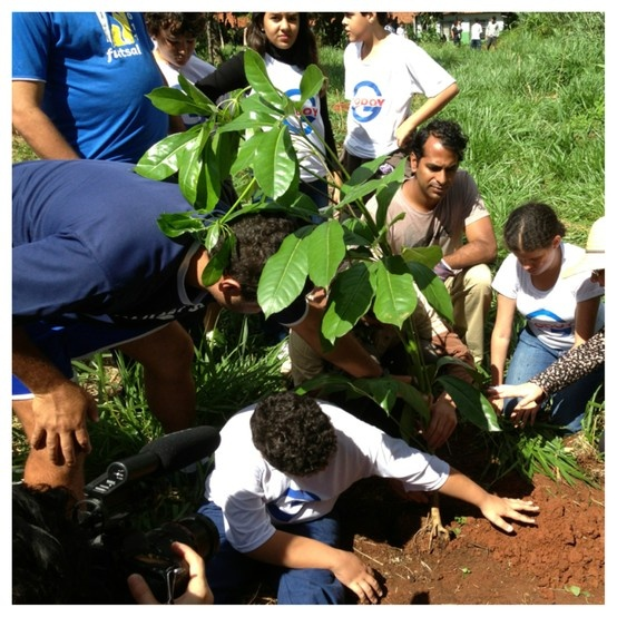 """This image is of Jorge and Cem assisting a plant with a girl with no vision and a boy with limited leg use.   As I watched them make their way to the planting sight and the plant itself I did have tears in my eyes. It was a super power full thing to watch. Cem from the FTPF said it was one of his most powerful plants :)"" ~ Chantal Girard of Vivid Image Studio."
