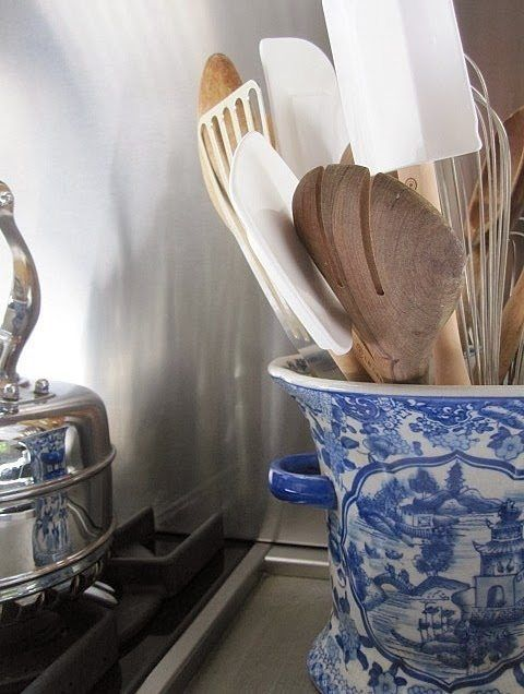 Pinterest I love this idea - use a blue and white Chinoiserie vase to corral your kitchen utensils!