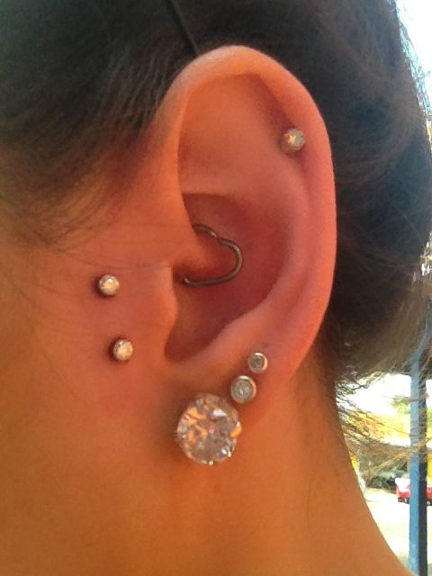 My ear piercings so far :D  1st, 2nd and 3rd lobes Daith Cartilage  and brand new today are my dermals opposite my tragus <3