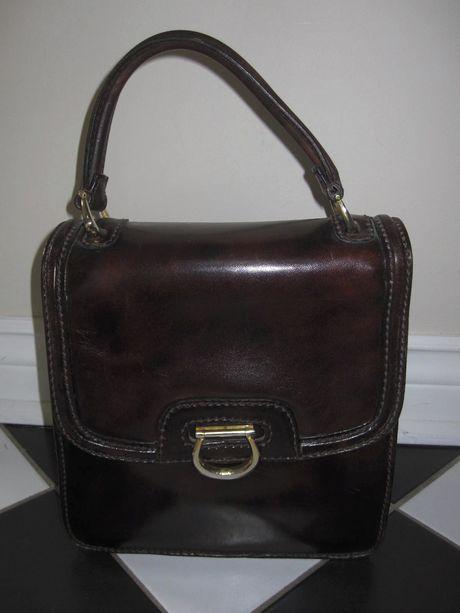 Shop my closet on @Jodie Guirey. I'm selling my Holt Renfrew: Brown Vintage Designer Handbag Bag. Only $199.00