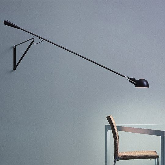 A dramatic swinging wall lamp, with a 7ft long arm. #TRNK