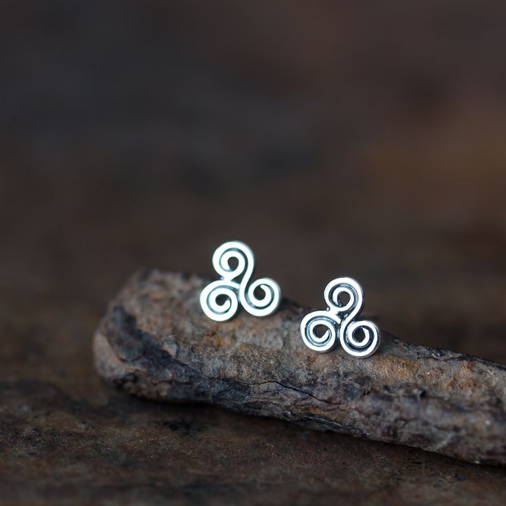 Small Celtic triskele earrings handmade from solid sterling silver, oxidized and polished. Post is soldered to the center of the shape. This stud earring design is my attempt to recreate a classic Cel