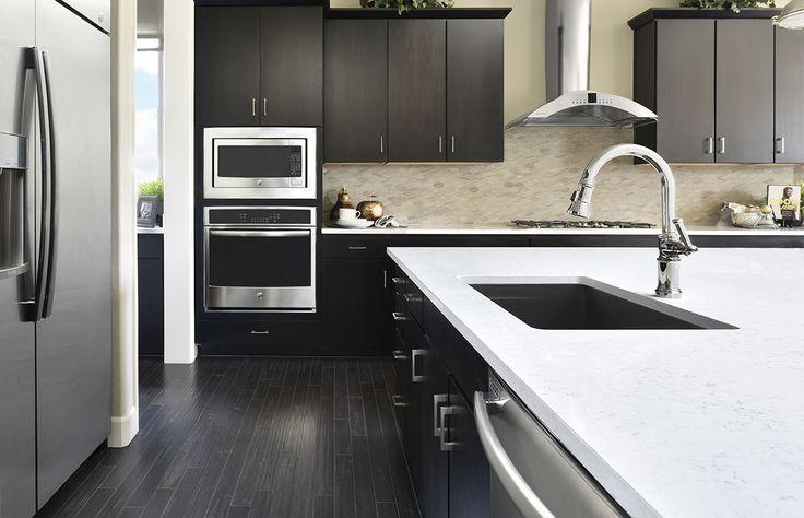Striking center island + convenient sink | Daley model home gourmet kitchen | Aurora, CO | Richmond American Homes