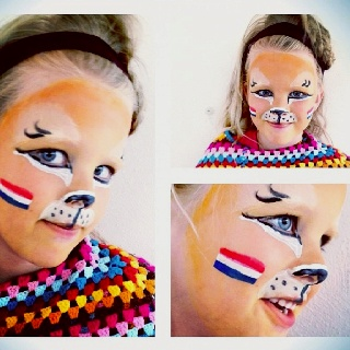 Holland vs. Germany at the Europian Championships Soccer 2012. Face painted Merle as a Dutch lion to cheer for our national team.