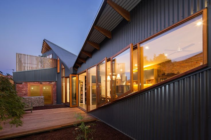 Love these timber angled windows with the corrugated iron. Contemporary Exterior by Maxa Design