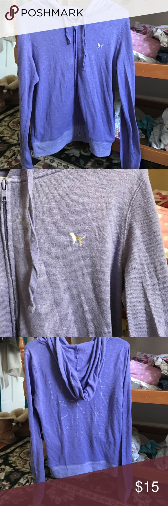 Purplish blue zip up hoodie from Victoria secrets Only worn a couple times. it's light weight with silver accents it's a size small but fits more like a medium! PINK Victoria's Secret Tops Sweatshirts & Hoodies