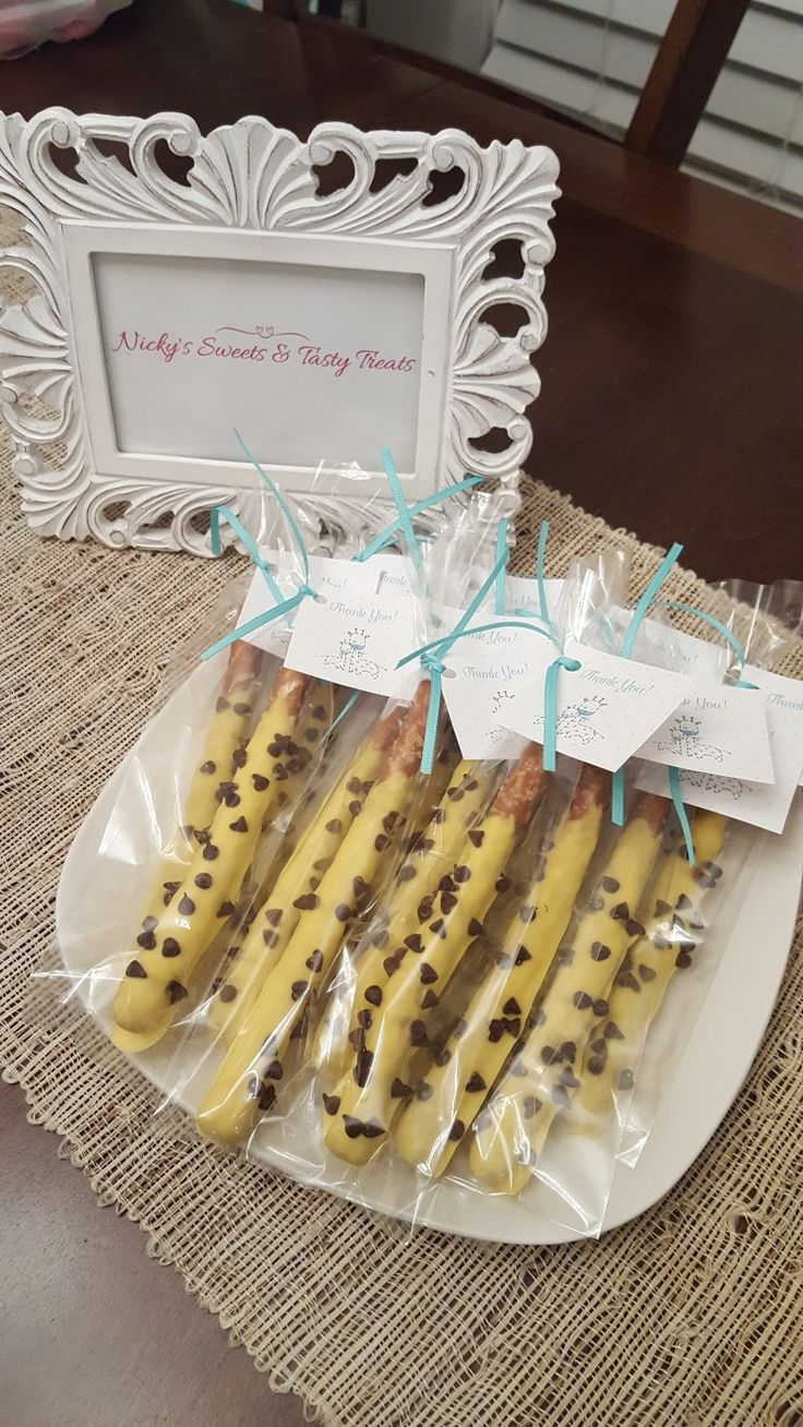 A giraffe themes baby shower.. chocolate covered pretzel rods with mini chocolate chips