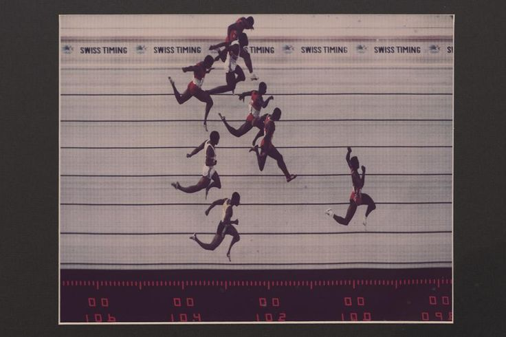 Carl Lewis crossing the finish line at the 100m race in the 1984 Summer Olympics at the Los Angeles Memorial Coliseum, 1984