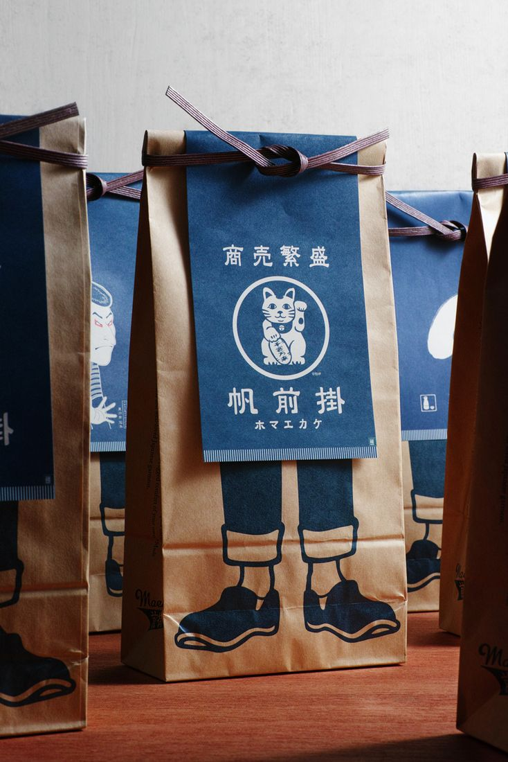 Maekake are a type of Japanese apron that, for hundreds of years, have been favored by the working men and women of rice shops, sake shops, miso shops and other stores that dot Japan's many shopping streets. They're typically made from indigo-dyed cotton canvas and feature a thick belt that wraps al