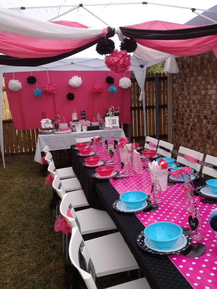 Minnie Mouse party gazebo. Great use of plastic tablecloths for ceiling draping.