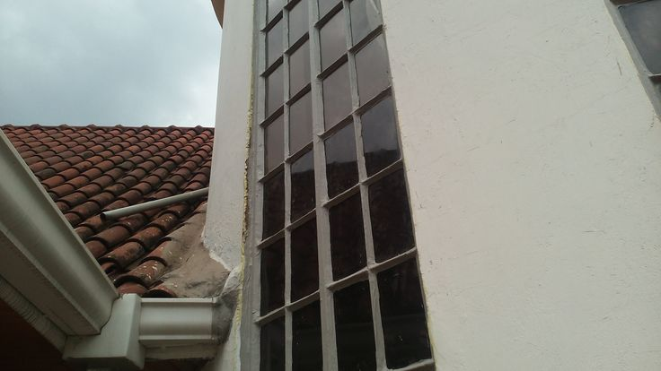 GREY LIQUID FLEXIBLE RUBBER applied to leaking window seals of a residential house
