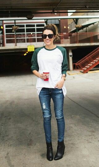 white and green baseball tee, jeans, and black ankle boots