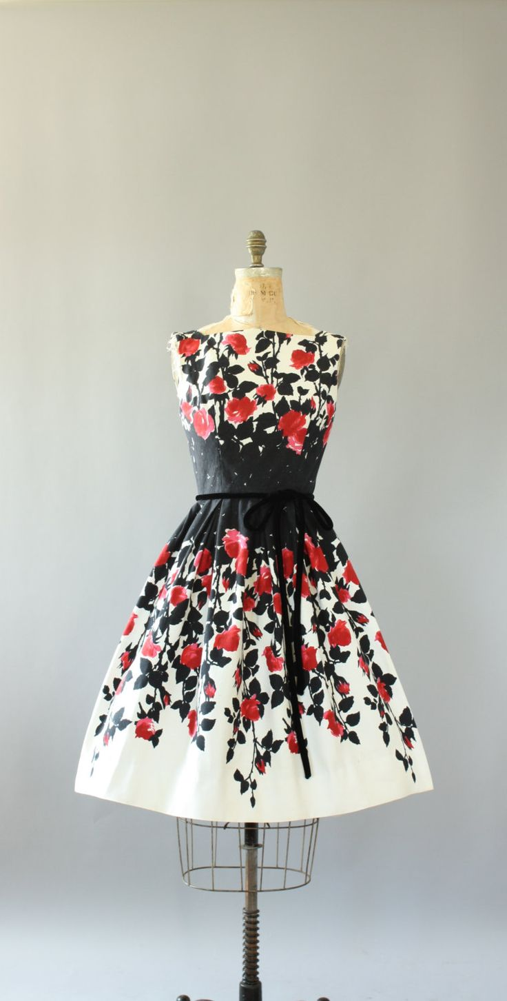 Vintage 50s Arkay red and black floral border print cotton piqué dress. Black velour cord belt. Full skirt. Metal zipper up back. Crinoline