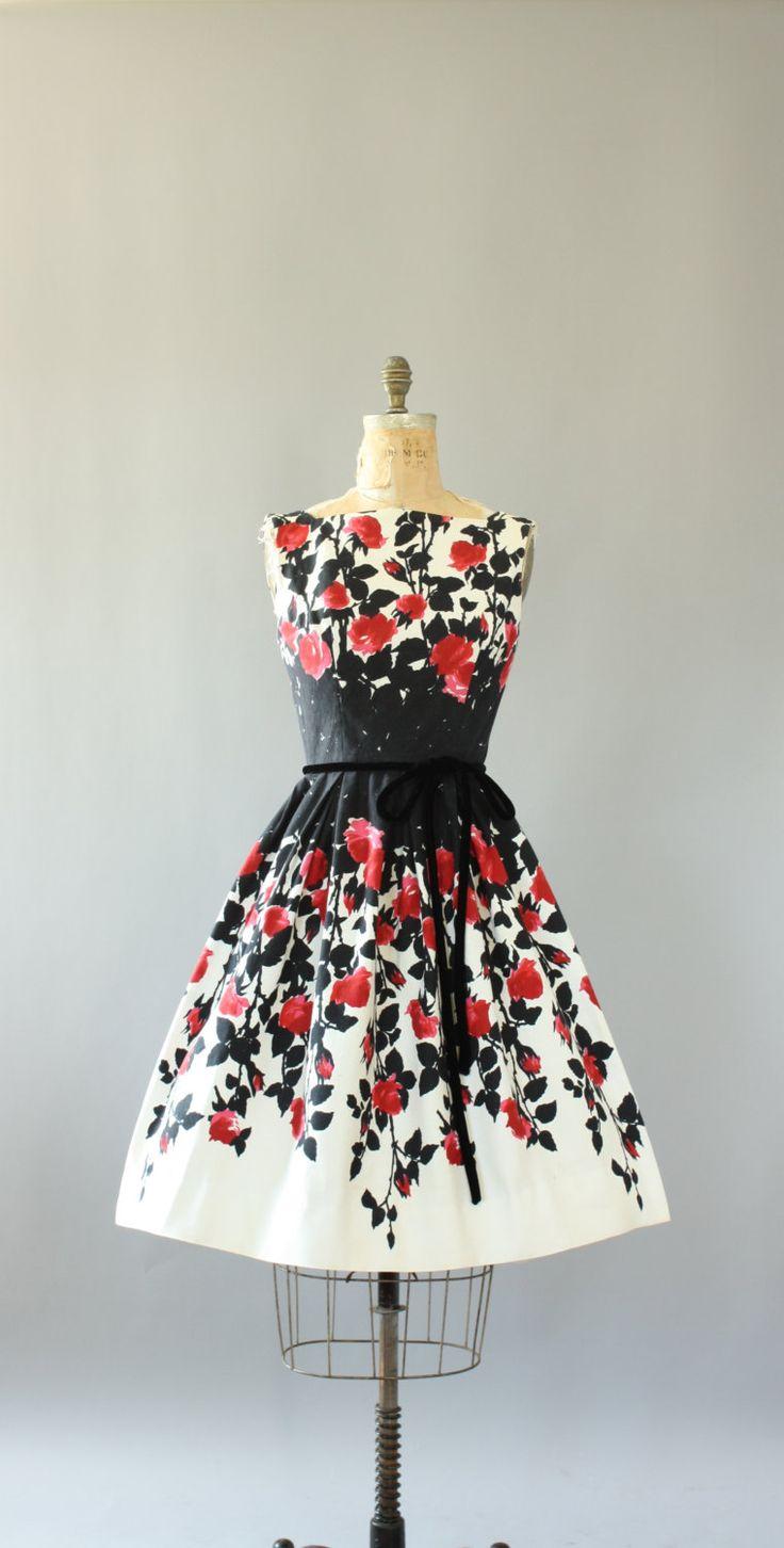 Vintage 50s Arkay red and black floral border print cotton piqué dress. Black velour cord belt. Full skirt. Metal zipper up back. Crinoline