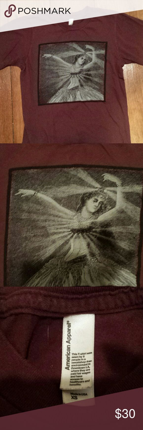 Rare neutral milk hotel shirt from their last tour I bought this shirt in January 2014 on neutral milk hotel's reunion tour, their last tour ever. It's a men's American apparel super soft, little stretchy xs shirt. It is maroon and has an awesome graphic of an antique dancer. The back is blank. I'm sorry to let this go but I never wear it, my loss is your gain. Indie, lo-fi, hipster, band, urban outfitters American Apparel Tops Tees - Short Sleeve