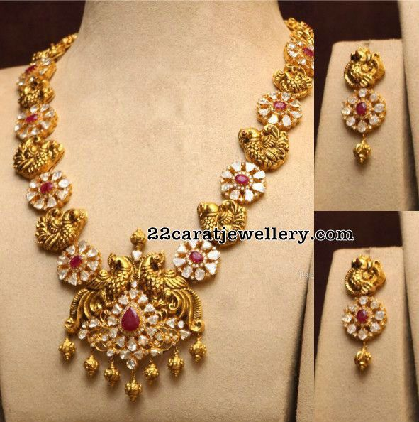 Pachi Peacock Necklace,with flat diamonds pearls rubies and emaralds in 120 grams