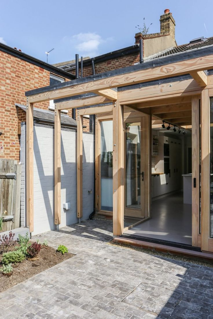Timber portals frame windows and skylights in this garden-facing extension in Peckham by Nimtim Architects.