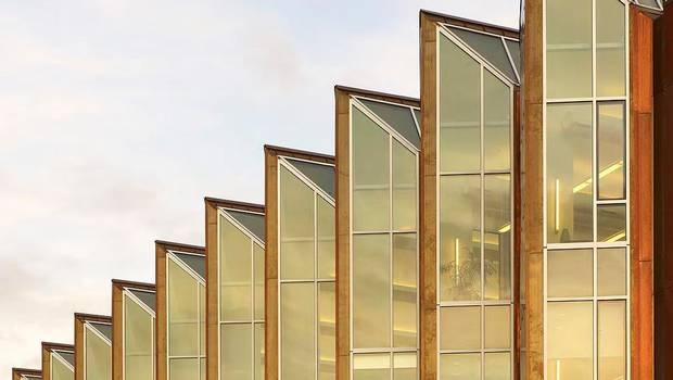 Distinctive gold-tinted windows on an exterior wall of the Centennial College's new multi-purpose library and academic building face busy Highway 401, part of the TransCanada. (Paul French/Diamond and Schmitt Architects)