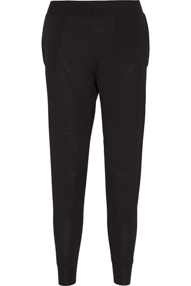 Stella McCartney's track pants have been spun in Italy from virgin wool. Designed with a ribbed waistband and cuffs, this cozy pair has a slouchy fit and tapered leg. Wear yours with a chunky knit and sandals.
