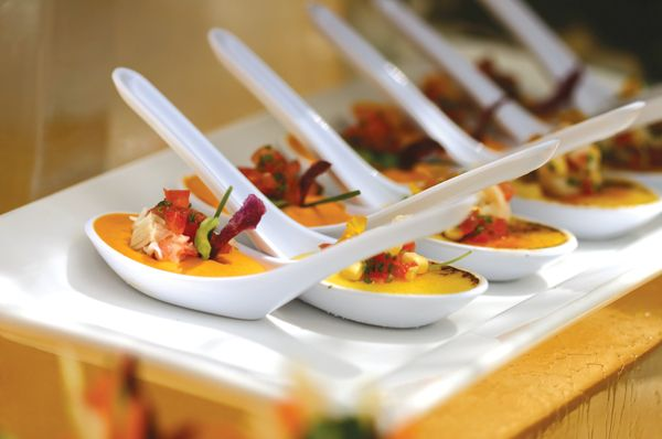 Saffron seafood custard with crab, tomatoes, and basil in Chinese spoons