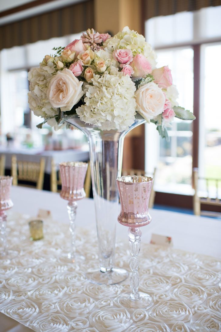 Tall Glass Vases With Spring Bouquets Of Roses And