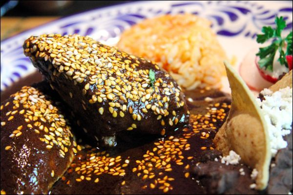 Mole Poblano.  Mexico's Best Mole Poblano?  Mole Poblano is a classic Mole version sauce whic is dark red or brown.  Uses two or more different types if chiles.  Depending on the type of mole, it may have 20-30 ingredients and may take up to a day to make.