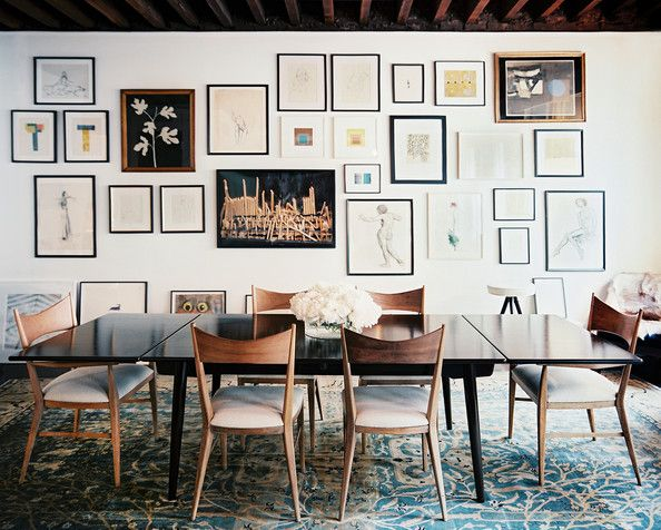 A collection of art in Julia Leach's dining space.