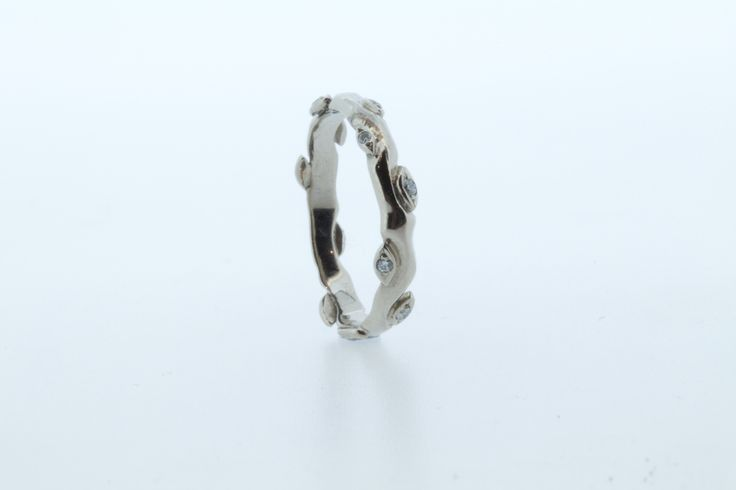 Beautiful rose and thorn wedding ring in white gold