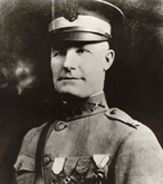 While he was leading his company against the enemy, his line came under heavy machine-gun fire, which threatened to hold up the advance. Followed by two...